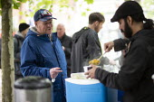 Street soup kitchen for the homeless, Manchester. Curry and tea provided by local volunteers - John Harris - 2010s,2019,BAME,BAMEs,Black,BME,bmes,charitable,charity,cities,City,diversity,ethnic,ethnicity,excluded,exclusion,feed,feeding,feeds,food,FOODS,giving,HARDSHIP,help,helping,homeless,homelessness,impov