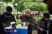 Street soup kitchen for the homeless, Manchester. Curry and tea provided by local volunteers - John Harris - 2010s,2019,BAME,BAMEs,Black,BME,bmes,cities,City,diversity,ethnic,ethnicity,excluded,exclusion,feed,feeding,feeds,food,FOODS,HARDSHIP,homeless,homelessness,impoverished,impoverishment,INEQUALITY,kitch