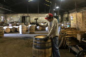 Louisville, Kentucky, USA: Workers at Kelvin Cooperage making oak barrels for aging bourbon and wine - Jim West - 2010s,2019,american,americans,barrel,barrel maker,barrel making,barrels,bourbon,capitalism,cask,casks,cooper,cooperage,coopers,EBF,Economic,Economy,employee,employees,Employment,FACTORIES,factory,hamm