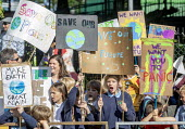 School children from Sefton Park School protest about climate change, Bristol - Paul Box - 2010s,2019,activist,activists,against,anti,CAMPAIGN,campaigner,campaigners,CAMPAIGNING,CAMPAIGNS,child,CHILDHOOD,children,Climate Change,DEMONSTRATING,Demonstration,DEMONSTRATIONS,environment,Environm