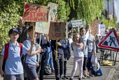 School children from Sefton Park School protest about climate change, Bristol. - Paul Box - 2010s,2019,activist,activists,against,anti,boy,boys,CAMPAIGN,campaigner,campaigners,CAMPAIGNING,CAMPAIGNS,child,CHILDHOOD,children,Climate Change,DEMONSTRATING,Demonstration,DEMONSTRATIONS,environment