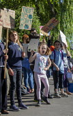 School children from Sefton Park School protest about climate change, Bristol. - Paul Box - 2010s,2019,activist,activists,against,anti,CAMPAIGN,campaigner,campaigners,CAMPAIGNING,CAMPAIGNS,child,CHILDHOOD,children,Climate Change,DEMONSTRATING,Demonstration,DEMONSTRATIONS,environment,Environm