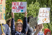 School children from Sefton Park School protest about climate change, Bristol. - Paul Box - 2010s,2019,activist,activists,against,anti,CAMPAIGNING,CAMPAIGNS,child,CHILDHOOD,children,Climate Change,DEMONSTRATING,Demonstration,environment,Environmental degradation,Extinction Rebellion,female,f