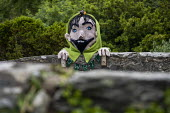 Mythical giant called Gwril in Llwyngwril, yarn bombing or guerrilla knitting in the quirky little Welsh village, it knits creations through the winter as a community project to decorate the village i... - Jess Hurd - 2010s,2019,ACE,armed,art,arts,BOMB,bombing,bombings,BOMBS,Cambrian Coast,Coast,coastal,coasts,communities,community,crochet,culture,decorate,giant,graffiti,guerilla,guerillas,guerrilla,guerrilla knitt