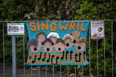 Singwril, singing group, Yarn bombing or guerrilla knitting in Llwyngwril, the quirky little Welsh village knits creations through the winter as a community project to decorate the village in the summ... - Jess Hurd - 2010s,2019,ACE,armed,art,arts,BOMB,bombing,bombings,BOMBS,Cambrian Coast,Choir,Coast,coastal,coasts,communities,community,crochet,culture,decorate,graffiti,guerilla,guerillas,guerrilla,guerrilla knitt