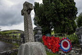 World War Memorial poppies, Yarn bombing or guerrilla knitting in Llwyngwril, the quirky little Welsh village knits creations through the winter as a community project to decorate the village in the s... - Jess Hurd - 2010s,2019,ACE,armed,armed forces,art,arts,BOMB,bombing,bombings,BOMBS,Cambrian Coast,Celtic cross,Coast,coastal,coasts,communities,community,crochet,culture,decorate,floral tribute,floral tributes,fl