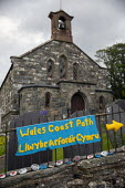 Wales Coastal Path, Yarn bombing or guerrilla knitting in Llwyngwril, the quirky little Welsh village knits creations through the winter as a community project to decorate the village in the summer mo... - Jess Hurd - 25-06-2019