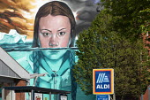 Greta Thunberg mural Bristol, painted by Jody Thomas a Bristol Graffiti artist. It depicts Swedish climate change activist Greta Thunberg being submerged in water as global warming melts the icecaps r... - Paul Box - 2010s,2019,ACE,activist,activists,against,Aldi,art,arts,artwork,artworks,autism,autistic,Behavioural,campaigner,campaigners,CAMPAIGNING,CAMPAIGNS,Climate Change,culture,DEMONSTRATION,difficulties,diso