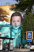 Greta Thunberg mural Bristol, painted by Jody Thomas a Bristol Graffiti artist. It depicts Swedish climate change activist Greta Thunberg being submerged in water as global warming melts the icecaps r... - Paul Box - 2010s,2019,ACE,activist,activists,against,Aldi,art,arts,artwork,artworks,autism,autistic,Behavioural,CAMPAIGN,campaigner,campaigners,CAMPAIGNING,CAMPAIGNS,Climate Change,culture,DEMONSTRATING,DEMONSTR