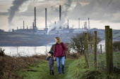 Valero Oil Refinery, Milford Haven, Pembrokeshire - Paul Box - 2010s,2019,adult,adults,Air Pollution,Air Quality,boy,boys,C02 Emissions,child,childhood,children,chimney,chimneys,coast,coastal,coasts,EBF,Economic,Economy,ENI,environment,environmental degradation,E