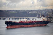 Oil Tanker underway from Valero Oil Refinery, Rhoscrowther, Pembroke, Pembrokeshire - Paul Box - 2010s,2019,boat,boats,capitalism,coast,coastal,coasts,dock,docks,dockside,EBF,Economic,Economy,harbor,harbors,harbour,harbours,import,IMPORTED,imports,Industries,industry,infrastructure,marine,maritim