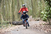 3 year old boy and mother riding mountain bikes, Ashton court, Bristol - Paul Box - 03-05-2017