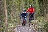 3 year old boy and mother riding mountain bikes, Ashton court, Bristol - Paul Box - 2010s,2019,adult,adults,bicycle,bicycles,BICYCLING,Bicyclist,Bicyclists,bike,bikes,Biking Trail,boy,boys,child,childhood,children,country,countryside,court,cycle,cycles,cycling,Cyclist,Cyclists,exerci
