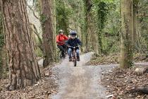 3 year old boy and mother riding mountain bikes, Ashton court, Bristol - Paul Box - 03-05-2017