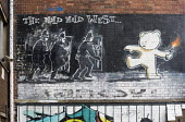 Banksy The Mild Mild West, Bristol. - Paul Box - 2010s,2019,ACE,art,arts,artwork,artworks,Banksy,cities,City,culture,Graffiti,Molotov Cocktail,mural,MURALS,Painting,paintings,Petrol Bomb,petrol bombs,Riot Police,scene,scenes,shield,shields,street,st