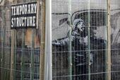 Banksy Graffiti on a garage, Port Talbot, Wales - Paul Box - 2010s,2019,ACE,art,arts,artwork,artworks,Banksy,culture,factory,garage,graffiti,mural,murals,Painting,paintings,plant,Port,ports,STEEL,steel industry,steel making,STEELMAKER,steelmaking,steelworks,str