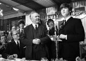 The Beatles receiving the Variety Club Award from Harold Wilson London 1964. 'Show Business Personalities Of 1963' - Romano Cagnoni - 1960s,1964,ACE,awards,Business,Club,clubs,entertainment,George Harrison,Harold Wilson,honor,honour,John Lennon,John Paul George and Ringo,Labour Party,London,male,man,men,MP,MPs,people,person,persons,