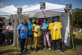NEU Stall, UK Black Pride, Haggerston Park, East London - Jess Hurd - 2010s,2019,ACE,activist,activists,against,BAME,BAMEs,Black,Black Pride,BME,bmes,CAMPAIGNING,CAMPAIGNS,Culture,DEMONSTRATING,Demonstration,diversity,equal,ethnic,ethnicity,FEMALE,Festival,festivals,Gay