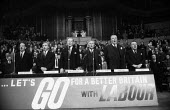 The top table in song, Labour Party Rally, Albert Hall, London 1964 - Romano Cagnoni - 1960s,1964,Harold Wilson,Labour,Labour Party,London,male,man,men,MP,MPs,Party,people,person,persons,POL,political,politician,politicians,politics,rallies,Rally,singing,song,songs