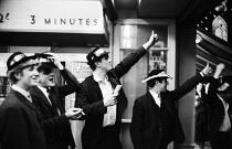 Young British men on holiday Blackpool 1965 - Romano Cagnoni - 1960s,1965,Blackpool,COAST,coastal,coasts,cowboy hat,enjoying,enjoyment,fun,funny,hat,hats,holiday,holiday maker,holiday makers,holiday resort,holidaymaker,holidaymakers,holidays,Humor,HUMOROUS,HUMOUR