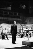 Peter Maxwell Davies bowing after a performance of his Sonata for 17 Wind Instruments played by the London Philharmonic Orchestra and conducted by William Steinberg, Royal Festival Hall 1960Peter Maxw... - Alan Vines - 1960,1960s,ACE,arts,classical music,classical musician,composer,concert,concerts,conducting,conductor,conductors,culture,entertainment,Festival,FESTIVALS,London,Maxwell,Maxwell Davies,melody,music,MUS