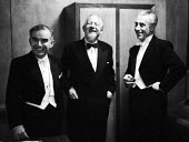 Violinist Endre Wolf, composer Edmund Rubbra and conductor Rudolf Schwarz, dressing room, Royal Festival Hall after a performance of Edmund Rubbra Violin Concerto by the BBC Symphony Orchestra 1960Vio... - Alan Vines - 1960,1960s,ACE,arts,BBC,classical music,classical musicians,Composer,Composers,concert,concerts,conducting,conductor,conductors,culture,Edmund Rubbra,Endre Wolf,entertainment,Festival,FESTIVALS,melody