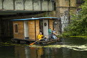 Paddling houseboat, Regents Canal, East London - Jess Hurd - 2010s,2019,activities,boat,boating,boats,canal,canals,child,childhood,children,cities,City,East London,families,family,female,females,girl,girls,hobbies,hobby,hobbyist,holiday,holiday maker,holiday ma