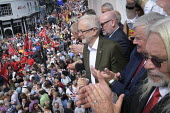 2019 Durham Miners Gala, Jeremy Corbyn, Tosh McDonald ASLEF on the balcony of the County Hotel - Mark Pinder - 2010s,2019,applauding,applause,ASLEF,DMA,Durham Miners Gala,Hotel,HOTELS,Jeremy Corbyn,Labour Party,member,member members,members,MINER,Miners,MINER'S,MP,MPs,NUM,parade,POL,political,politician,politi