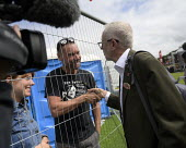 Jeremy Corbyn shaking hands with a supporter, 2019 Durham Miners Gala - Mark Pinder - 2010s,2019,camera,cameras,communicating,communication,DMA,Durham Miners Gala,filming,greeting,hands,Jeremy Corbyn,Labour Party,male,man,member,member members,members,men,MINER,Miners,MINER'S,MP,MPs,NU