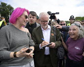 Jeremy Corbyn signing an autograph for a supporter, 2019 Durham Miners Gala - Mark Pinder - 2010s,2019,autograph,AUTOGRAPHS,DMA,Durham Miners Gala,FEMALE,interacting,interaction,Jeremy Corbyn,Labour Party,male,man,member,member members,members,men,MINER,Miners,MINER'S,MP,MPs,NUM,people,perso