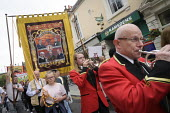 2019 Durham Miners Gala, banner and Brass band playing - Mark Pinder - 2010s,2019,ACE,Arts,band,bands,Brass Band,cornet,Culture,DMA,Durham Miners Gala,male,man,melody,member,member members,members,men,MINER,Miners,MINER'S,music,MUSICAL,musical instrument,musical instrume
