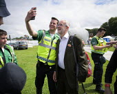 Jeremy Corbyn selfie with a supporter, 2019 Durham Miners Gala - Mark Pinder - 2010s,2019,CAMERA,camera phone,cameras,DMA,Durham Miners Gala,Jeremy Corbyn,Labour Party,male,man,member,member members,members,men,MINER,Miners,MINER'S,MP,MPs,NUM,people,person,persons,photograph,pho