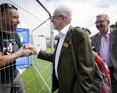 Jeremy Corbyn shaking hands with a supporte and Len McCluskey, Unite, 2019 Durham Miners Gala - Mark Pinder - 2010s,2019,DMA,Durham Miners Gala,greeting,hands,Jeremy Corbyn,Labour Party,male,man,member,member members,members,men,MINER,Miners,MINER'S,MP,MPs,NUM,people,person,persons,POL,political,politician,po