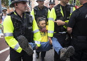Extinction Rebellion protest, Bristol - Paul Box - 2010s,2019,activist,activists,against,arrest,arrested,arresting,CAMPAIGNING,CAMPAIGNS,CLJ,DEMONSTRATING,Demonstration,environment,environmental,Extinction Rebellion,force,Nonviolent Direct Action,OFFI