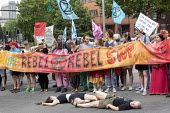 Extinction Rebellion protest, Bristol - Paul Box - 2010s,2019,activist,activists,against,CAMPAIGNING,CAMPAIGNS,DEMONSTRATING,Demonstration,environment,environmental,Extinction Rebellion,FEMALE,Nonviolent Direct Action,people,person,persons,Protest,PRO