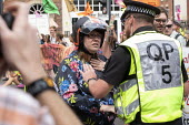 Extinction Rebellion protest, Bristol - Paul Box - 2010s,2019,activist,activists,against,CAMPAIGNING,CAMPAIGNS,CLJ,DEMONSTRATING,Demonstration,environment,environmental,Extinction Rebellion,FEMALE,force,OFFICER,officers,people,person,persons,POLICE,Po