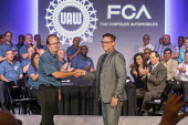 Michigan, USA: Fiat Chrysler and the UAW opening negotiations for the 2019 collective bargaining contract. UAW Pres. Gary Jones (L) shaking hands with FCA Chief Operating Officer Mark Stewart - Jim West - 2010s,2019,America,Auburn Hills,auto,automotive,Automotive Industry,bargain,bargaining,boss,bosses,capitalism,Car Industry,carindustry,ceremonies,ceremony,collective bargaining,contract,FCA,Fiat Chrys
