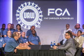 Michigan USA, Leaders of Fiat Chrysler and the UAW ceremonial opening of negotiations for the 2019 collective bargaining contract - Jim West - 2010s,2019,America,Auburn Hills,auto,automotive,Automotive Industry,bargain,bargaining,bargaining table,boss,bosses,capitalism,Car Industry,carindustry,ceremonies,ceremony,collective bargaining,contra