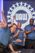 Michigan, USA: Fiat Chrysler and the UAW opening negotiations for the 2019 collective bargaining contract. UAW Pres. Gary Jones raising his fist - Jim West - 2010s,2019,America,Auburn Hills,auto,automotive,Automotive Industry,bargain,bargaining,capitalism,Car Industry,carindustry,ceremonies,ceremony,collective bargaining,contract,FCA,Fiat Chrysler,Gary Jon