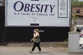 Obesity is a cause of cancer too advertisement Cancer Research UK obesity campaign, which highlights excess weight as a cause of cancer. The billboard looks like a cigarette packet. Some members of th... - John Harris - 2010s,2019,advertisement,advertisements,advertising,billboard,billboards,bodies,body,campaign,campaigning,CAMPAIGNS,cancer,CANCERS,charitable,charity,fat,FEMALE,giving,HEA,Health,help,helping,hoarding