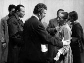 Berliner Ensemble first visit to UK to stage Mother Courage by Bertolt Brecht London 1956. Italian opera director Giorgio Strehler with Helene Weigel as Mother Courage and other members of the Ensembl... - Alan Vines - 1950s,1956,1st,ACE,ACTING,Actor,actors,adult,adults,author,AUTHORS,Berliner Ensemble,Bertolt Brecht,Brecht,cities,City,communicating,communication,conversation,conversations,culture,dialogue,director,
