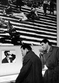 Berliner Ensemble first visit to UK to stage Mother Courage by Bertolt Brecht London 1956. Erich Franz (L) and Wolf Kaiser (R) at exhibition of 60 Years of Film with still from the famous steps scene... - Alan Vines - 1950s,1956,1st,ACE,ACTING,Actor,actors,adult,adults,author,AUTHORS,Battleship,BATTLESHIPS,Berliner Ensemble,Bertolt Brecht,Brecht,cities,City,culture,Ensemble,entertainment,Erich Franz,exhibition,FAMI