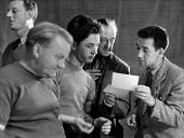Berliner Ensemble first visit to UK to stage Mother Courage by Bertolt Brecht London 1956. Actors from the Berliner Ensemble reading a letter together - Alan Vines - 1950s,1956,1st,ACE,ACTING,Actor,actors,adult,adults,arts,Berliner Ensemble,Bertolt Brecht,Brecht,cities,City,communicating,communication,conversation,conversations,culture,dialogue,discourse,discuss,d