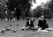 Berliner Ensemble first visit to UK to stage Mother Courage by Bertolt Brecht London 1956. Helga Raumer (L) and Annemarie Schlasbitz relaxing in St James park - Alan Vines - 1950s,1956,1st,ACE,ACTING,Actor,actors,adult,adults,Annemarie SchlasbitzACE arts,Berliner Ensemble,Bertolt Brecht,Brecht,cities,City,culture,Ensemble,entertainment,FAMILY,FEMALE,first,Helga raumer,Lei