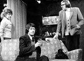 The Ruffian On The Stair by Joe Orton at the Soho Poly London 1973. From L to R Prunella Scales as Joyce, John Hurt as Wilson and David Warner as Mike - Peter Harrap - 1970s,1973,ACE,acting,actor,actors,Arts,culture,David Warner,drama,DRAMATIC,entertainment,FEMALE,fringe theatre,Joe Orton,John Hurt,London,male,man,men,people,person,persons,play,PLAYING,Prunella Scal