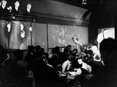 MC with guests at The Establishment Club London 1961. The Establishment Club was cteated by Peter Cook and Nicholas Luard in Greek Street in the West End of London with a fare of biting satire aimed a... - Romano Cagnoni - 17-11-1961