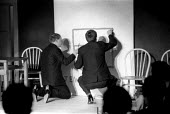"The Establishment Club London 1961. Painting ""racist"" graffiti as part of a comedy sketch. The Establishment Club was cteated by Peter Cook and Nicholas Luard in Greek Street in the West End of London... - Romano Cagnoni - 1960s,1961,ACE,Anti Racism,anti racist,Arts,bigotry,biting,cities,City,Club,clubs,comedian,comedians,comedy,culture,deference,DISCRIMINATION,ENTERTAINER,ENTERTAINERS,entertainment,FUNNY,graffiti,Greek"