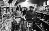 American women shopping in a USAF commissary, RAF Lakenheath Suffolk 1957 - Kurt Hutton - 1950s,1957,airfield,airforce,airman,american,americans,armed forces,bought,business,buy,buyer,buyers,buying,cheerios,commissary,consumer,consumers,customer,customers,EBF,Economic,Economy,FEMALE,food,F