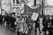International Womens Day demonstration 1974 - Chris Davies - 1970s,1974,activist,activists,against,banner,banners,CAMPAIGNING,CAMPAIGNS,cities,City,DEMONSTRATING,Demonstration,equal rights,equality,FEMALE,feminism,feminist,feminists,International Womens Day,IWD
