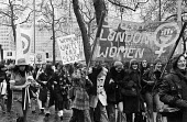 International Womens Day demonstration 1974 - Chris Davies - 1970s,1974,activist,activists,against,banner,banners,bigotry,CAMPAIGNING,CAMPAIGNS,cities,City,DEMONSTRATING,Demonstration,DISCRIMINATION,equal,equal rights,equality,FEMALE,feminism,feminist,feminists